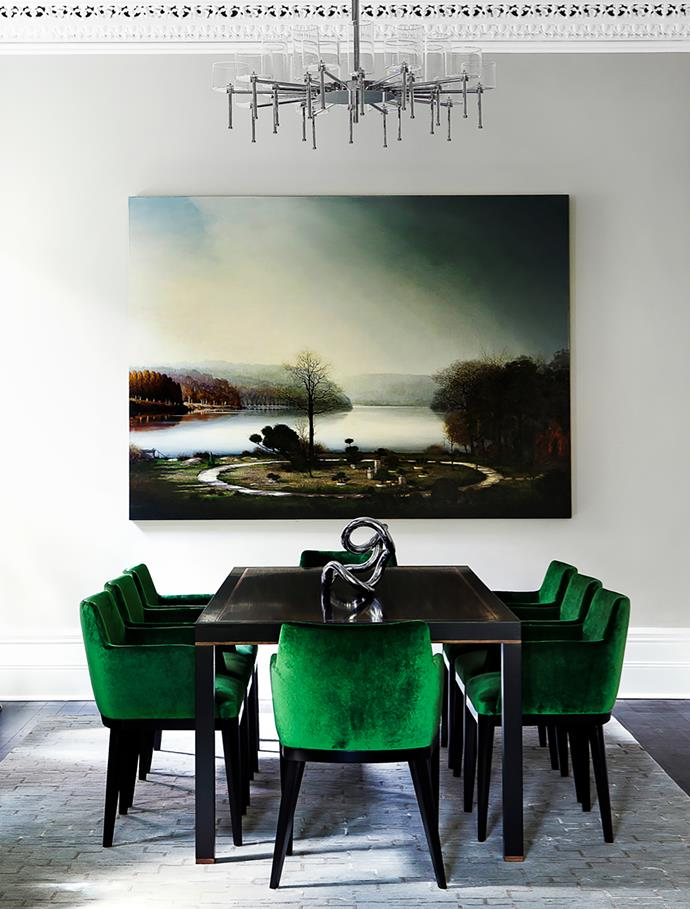 An Alexander McKenzie artwork, Bonsai, the Big Lesson, overlooks the custom-made macassar dining table by Brendan Wong and chairs upholstered in green Lelièvre 'Sultan' velvet. Robyn Cosgrove rug.