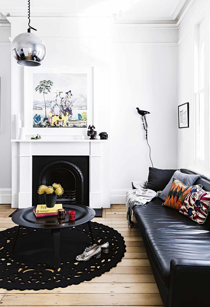 """For the family, moving out of the city has never been an option, so they've renovated twice to create a home that suits their urban lifestyle. """"Even though we're in central Sydney, there's a real sense of community,"""" says Nicola. """"I do feel as if we live in a little village sometimes.""""<br><br>**Living room** The painting above the fireplace is by Sulman Prize-winning artist Joan Ross. """"It suited our house perfectly,"""" says Nicola. """"Victorian era with fluoro – just like our house!"""" Artwork: Obey Giant by Shepard Fairly, [Obey Giant](https://obeygiant.com/