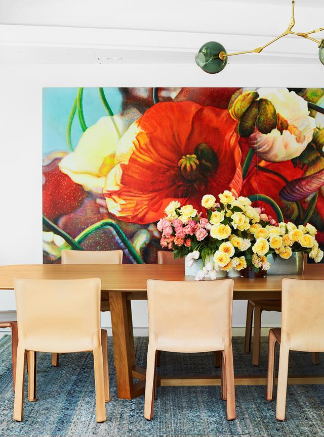 A bright Artwork by Tim Maguire from Martin Browne Contemporary makes a bold statement in this lively formal dining area conceived by Romaine Alwill of Alwill Interiors.