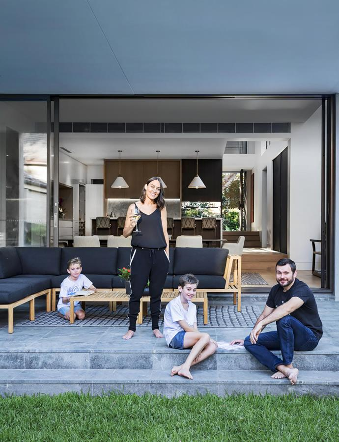 "Polly Manasiev with husband Bobby and sons Tommy (left) and Sammy in their new home. ""All the glass at the back brings in the north-eastern light. It's always bright inside,"" she says. Outdoor rug, Tribe Home. Designer buy: 'Watego' outdoor sofa, $5795, Eco Outoor."
