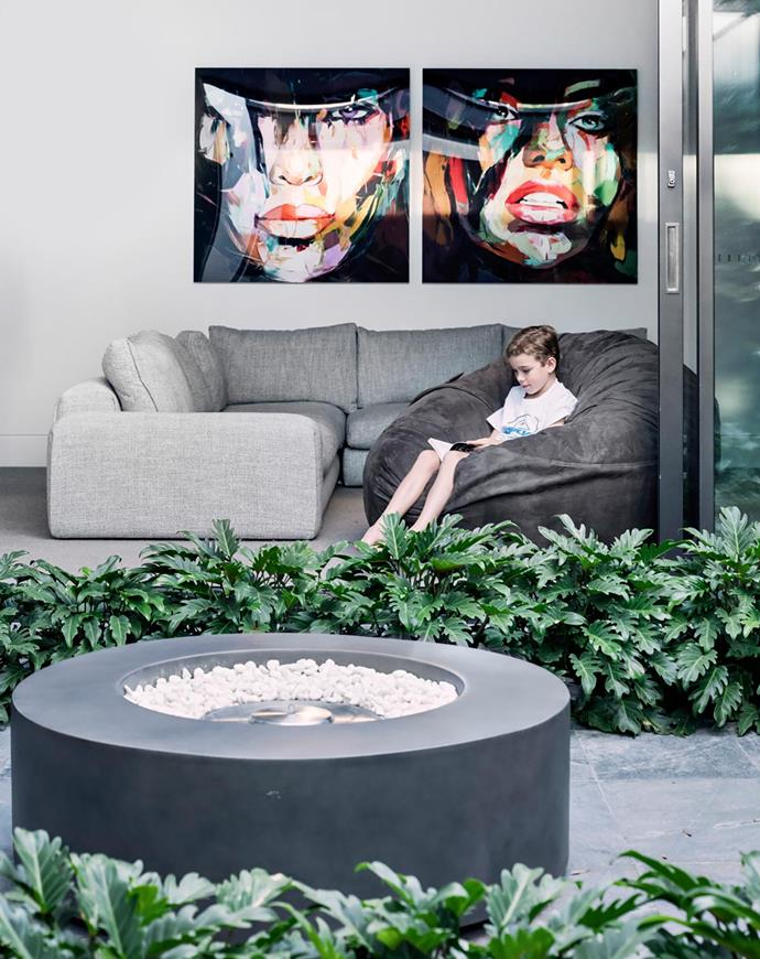 Tommy in a Moviesac foam-filled bag, Lovesac. Sofa, Jardan. Art prints by Françoise Nielly.