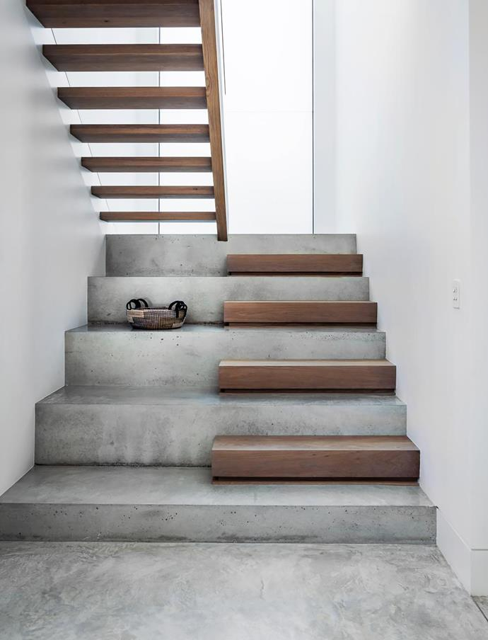The stairs are polished concrete with European oak treads, stained to match the ground floor. Basket, Tribe Home.