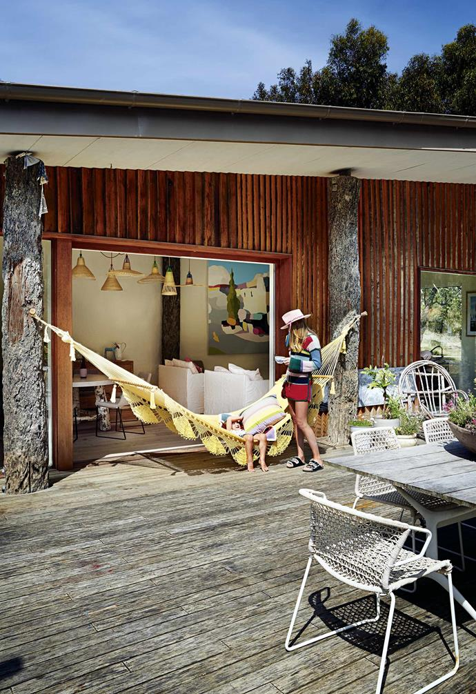"""Made from timber and rammed earth, with existing twisted tree trunks embedded into the build, alongside an abundance of floor-to-ceiling glass, this four-bedroom home ticked all of the boxes and then some.<br><br>**Outdoors** Fashion designer Arabella Ramsay shares this idyllic home with her family, including daughter Marlowe. The striped cushion is from her new lifestyle brand, [Dougal](https://dougalaustralia.com/