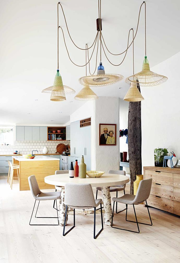 """Arabella and Chris swiftly purchased the property and, a short time later, the family swapped their Melbourne home for a laidback lifestyle by the beach. With a baby daughter and another on the way, it wasn't exactly a walk in the park.<br><br>**Kitchen and dining area** Pendant lamps from [Safari Living](https://www.instagram.com/safariliving/?hl=en
