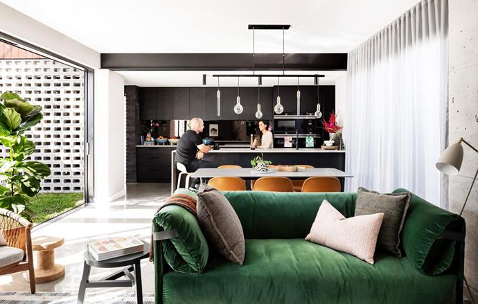 Concrete-topped dining table from Nood Co. Muuto 'Fiber' dining chairs and 'Visu' kitchen stools, Living Edge. Living zone: Rolf Benz sofa from Ultimo Interiors. Metal floor lamp, Ultimo Interiors. Pendant lights, Freedom.  'Luz' kitchen mixer with pull-out, Abey. Calligaris footed bowls (on rear bench), Ultimo Interiors. Bonnie and Neil tea towels, Remedy.