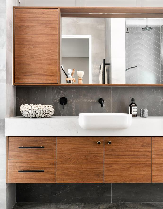 Caesarstone Calacatta Nuvo (on bench) and cupboards in Polytec Florentine Walnut create a warm ambience. 'Luna' semi-recessed basin, Caroma. 'Lucia' tapware, Abey.