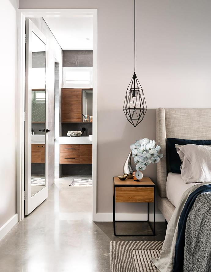 This downstairs space offers quiet and privacy for the adults. Sheets and pillowcases, Pure Linen. Waffle throw, Editeur. Silver vase and clock, Georg Jensen. Pendant light, Freedom. Smart buy: 'Drive 1' bedside table, $199, Freedom.