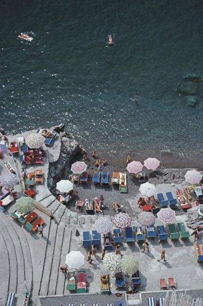 "Positano Beach 3 by Slim Aarons, from $510, [Fineprint Co](https://fineprintco.com/collections/slim-aarons/products/positano-beach?variant=29374087659543|target=""_blank""