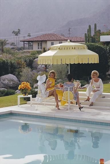 "Slim Aarons ""Nelda & Friends"" 1970, from $970, [At Home Style](https://athomestyle.com.au/collections/slim-aarons/products/copy-of-slim-aarons-dessert-house-party