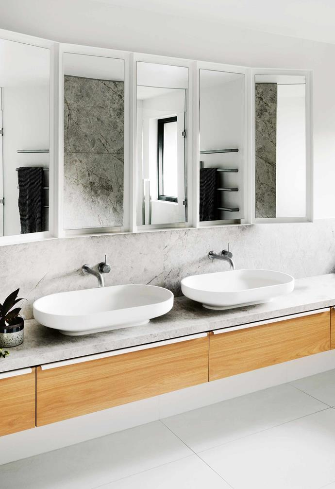"""**Mirror image** Marble will add instant luxe to a bathroom with its natural variations in tone and honed finish. What is less well known is how versatile this natural stone is as a style staple. In this [ensuite](https://www.homestolove.com.au/ensuite-bathroom-design-ideas-18820