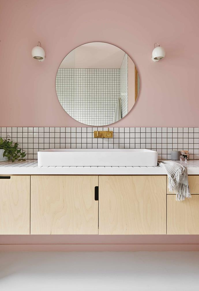 """**Geometry lesson** The aesthetically pleasing symmetry of line and shape equals graphic appeal in the ensuite of [this colourful home](https://www.homestolove.com.au/explore-an-interior-stylists-colourful-home-with-bold-ideas-7064