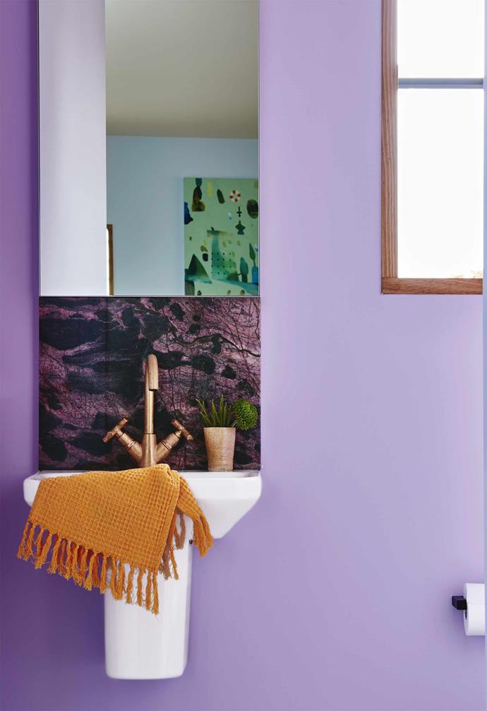 """**Purple reign** Small room, big colour statement. Awash in a pastel purple shade, this humble [powder room](https://www.homestolove.com.au/powder-room-design-20620
