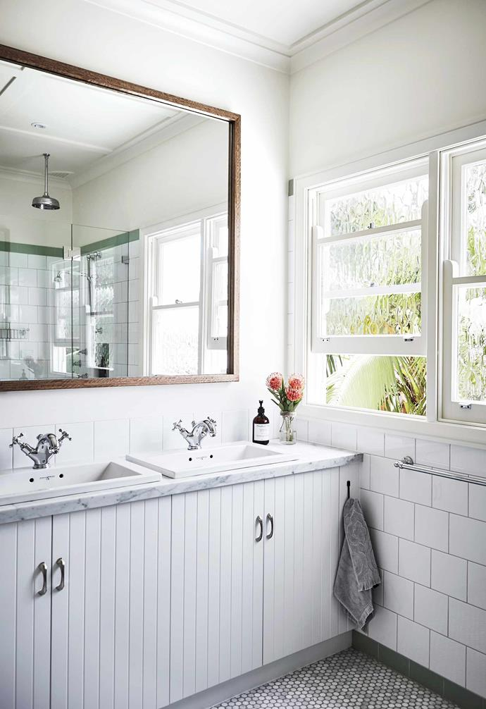 """**On reflection** The humble mirror is a mainstay of airy, bright bathrooms by bouncing light around a room to create the illusion of space. This custom mirror, designed by Alex Gourlay of [Vellum Interiors](https://velluminteriors.com.au/