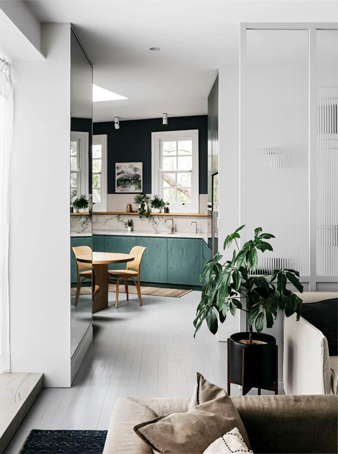 "A [triangular-shaped home](https://www.homestolove.com.au/modern-industrial-cafe-style-home-19429|target=""_blank"") in Sydney's Darlinghurst was given a modern-industrial, café-style makeover that respects the home's layered history and unique mix of Victorian and Federation style architecture. ""It feels relaxed and easy and has a nice flow across each level and into the courtyards,"" says designer Richard Stanisich."