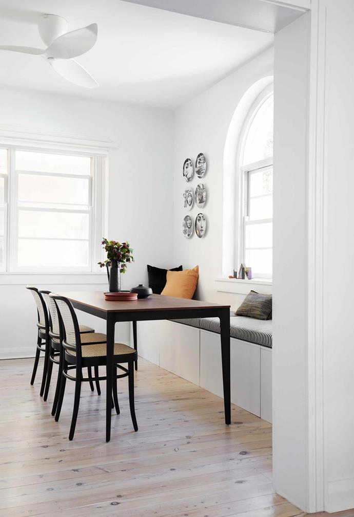"""**Dining/work space** In this multi-purpose zone, the banquette is upholstered in a grosgrain black fabric from [Elliott Clarke](https://www.elliottclarke.com.au/
