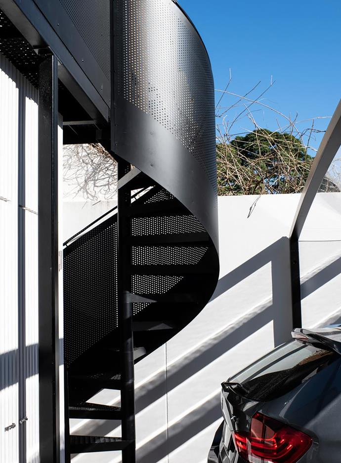 "The perforated metal balcony with spiral staircase, made by Enzie, serves as an extension of the dining space, says Alexandra. ""It is also practical, having direct access from the carport to the kitchen level. Now the lower level can operate entirely as a self-contained unit – the perfect guest house."""