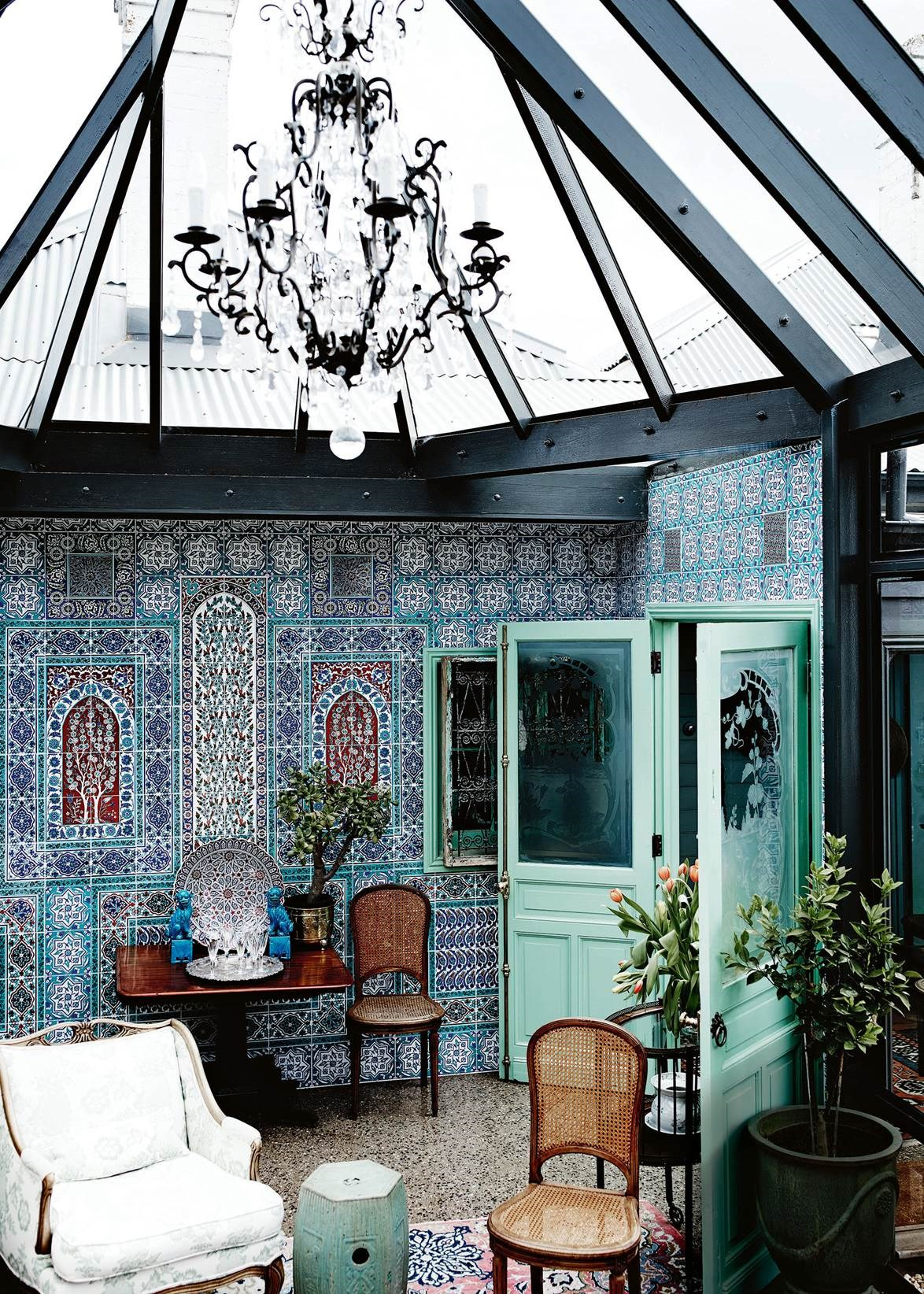 "A priest who moonlights as an interior designer turned an old cottage into a beautiful home complete with a conservatory. ""The building of the conservatory was a response to the beautiful garden,"" owner Jeff says, adding that the work scheduled to take four months blew out to two years. ""It has 26 opening windows… A bottomless pit of money went into this room but I'm thrilled with it — it's the gin and tonic room!"""