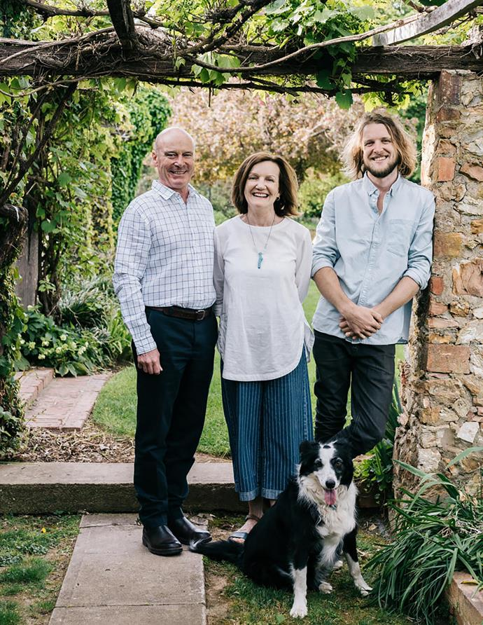 Alister, Rosa and son Matt (and border collie Pepper) under an arbour of stone pillars built by Eric Purbrick.