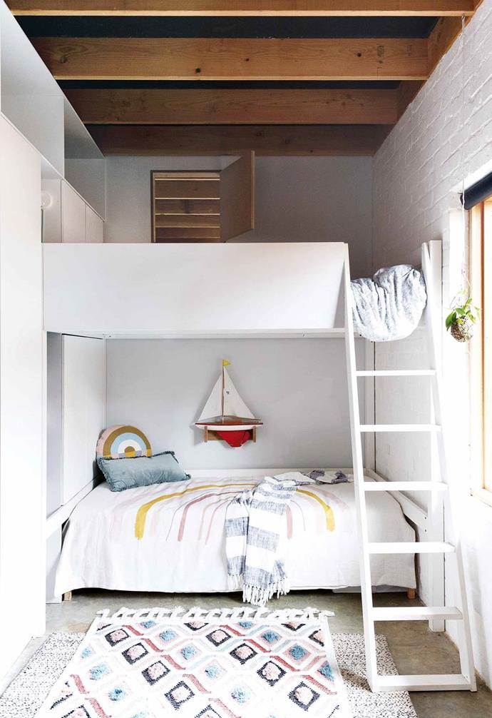 "In the build of this small [eco-friendly home](https://www.homestolove.com.au/small-eco-friendly-house-19983|target=""_blank"") in Perth, a custom double bunk bed was created to make the most of the compact footprint and tall ceilings of this kid's bedroom."