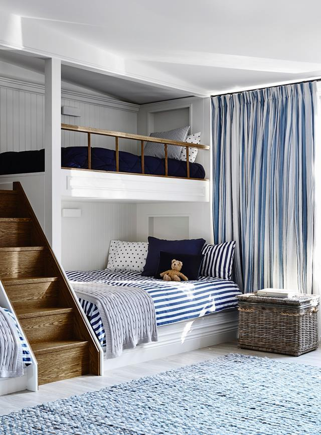 This coastal-style children's room designed by Adelaide Bragg boasts a luxe version of a bunk bed. The custom built-in beds are spacious with the bottom bunk being able to fit accommodate a double mattress.