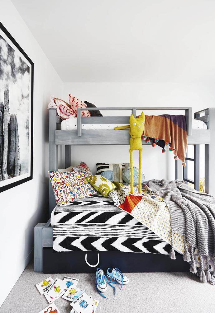 "The kids' bedroom within a [coastal abode](https://www.homestolove.com.au/coastal-holiday-home-19311|target=""_blank"") features a bunk bed with stowaway trundle. It maximises space while fun, colourful furnishings create a comfy retreat for the kids."