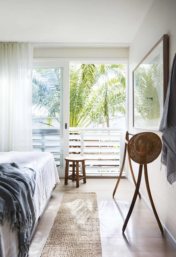 """Nothing is precious or shiny, and there's plenty of comfort in the form of beds, sofas, cotton and linen,"" Lucy adds. ""I used mattress ticking on some cushions, and the rest are made using fabric from Walter G, Marimekko and No Chintz.""<br><br>**Bedroom** The Canary Island date palm dominates the view. Bedding from [L&M Home](https://www.lmhome.com.au/