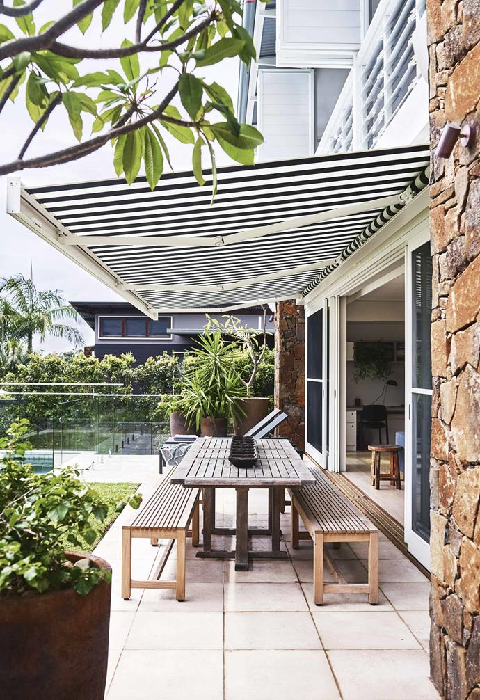 """When you come back from a surf, you can drop your board on the rack, have a warm shower, then dive into the pool,"" adds Lucy.<br><br>**Pool area** Teak outdoor benches from Jati complement the local basalt stone cladding. The folding-arm awning from [Blindmaster](http://www.blindmaster.com.au/