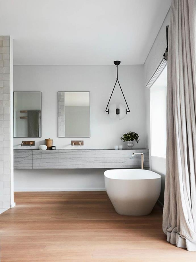Taking design cues from a luxury hotel, this bathroom by Justine Hugh-Jones and Katrina Mackintosh is an inviting, peaceful space where you want to linger. The streamlined marble vanity with integrated sinks and storage is designed to effortlessly float within the space, preserving clean lines and a sense of flow.