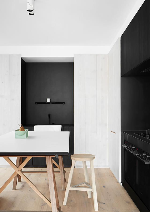 "Lashings of limed timber and a clean black and white palette swing in this [bold kitchen](https://www.homestolove.com.au/monochrome-timber-kitchen-design-19885|target=""_blank"") designed by Carole Whiting. Simplicity in the palette and materials and purity of form has resulted in an elegant, light-filled working kitchen."