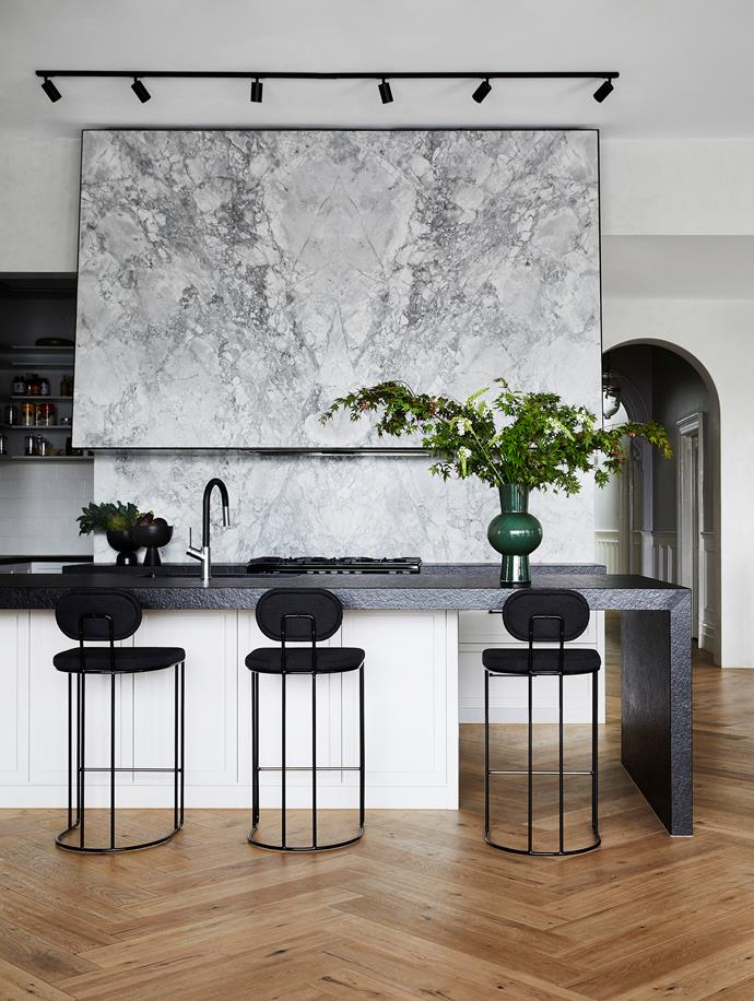 "The sweeping stone-clad rangehood in this highly functional yet refined kitchen by Kate Walker is a standalone style feature, as well as an engineering feat. ""While it is a very classic way to design a rangehood we made it look ultra-modern through the scale of it, taking it from head to ceiling height,"" says Kate."