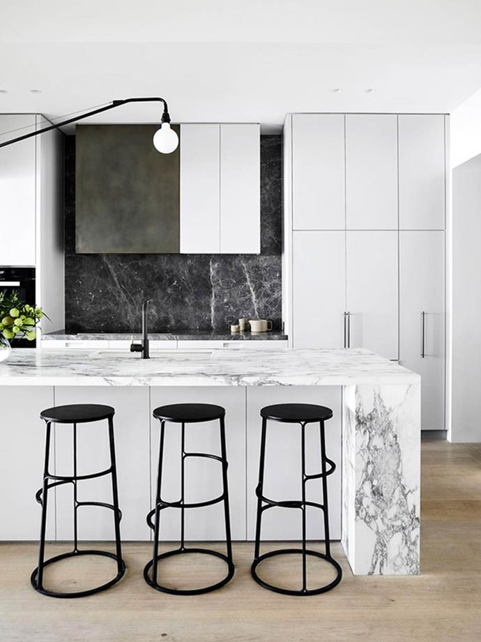 """The kitchen is richly layered with tactile materials. Natural inflections of mixed stone, aged bronze cladding and oak cabinetry give warmth, character and sincerity to the interior, mediating the home's traditional spirit with a contemporary overlay,"" says designer Fiona Lynch of this modern space."