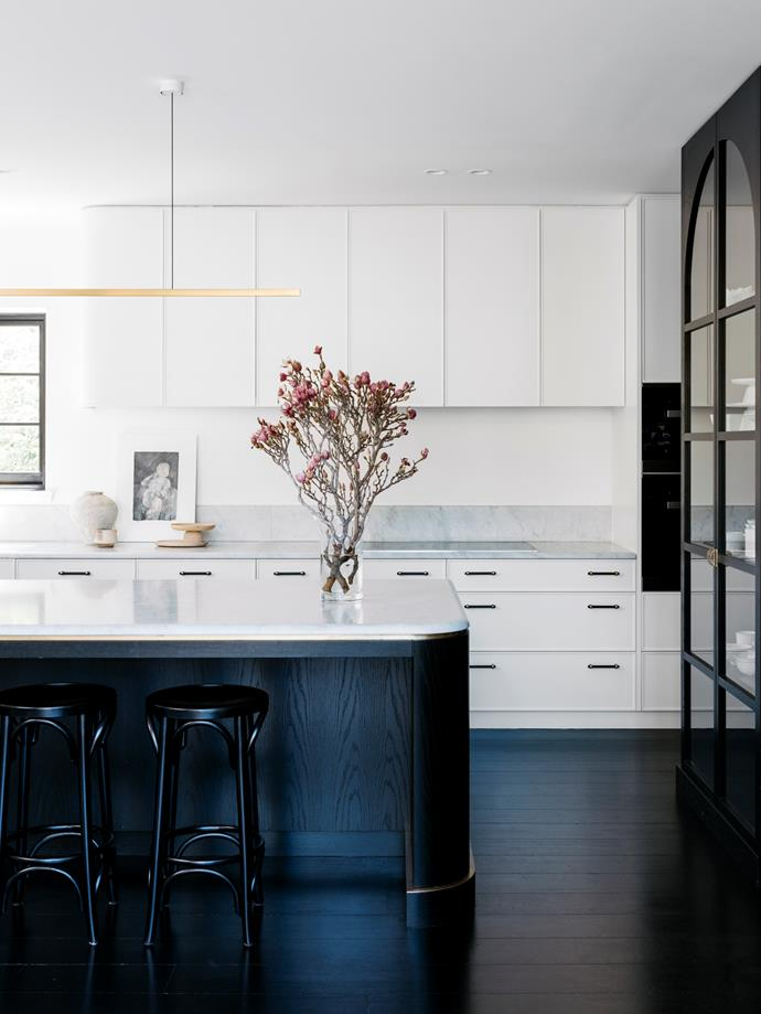 "The custom joinery's rolling curves balance the gutsiness of this purely monochromatic kitchen.  ""Meditating on the subtle details of the art deco era, this monochromatic kitchen is contemporary yet timeless. It is the centrepiece of a grand home steeped in history, elegance and extravagance,"" says designer Sarah-Jane Pyke."