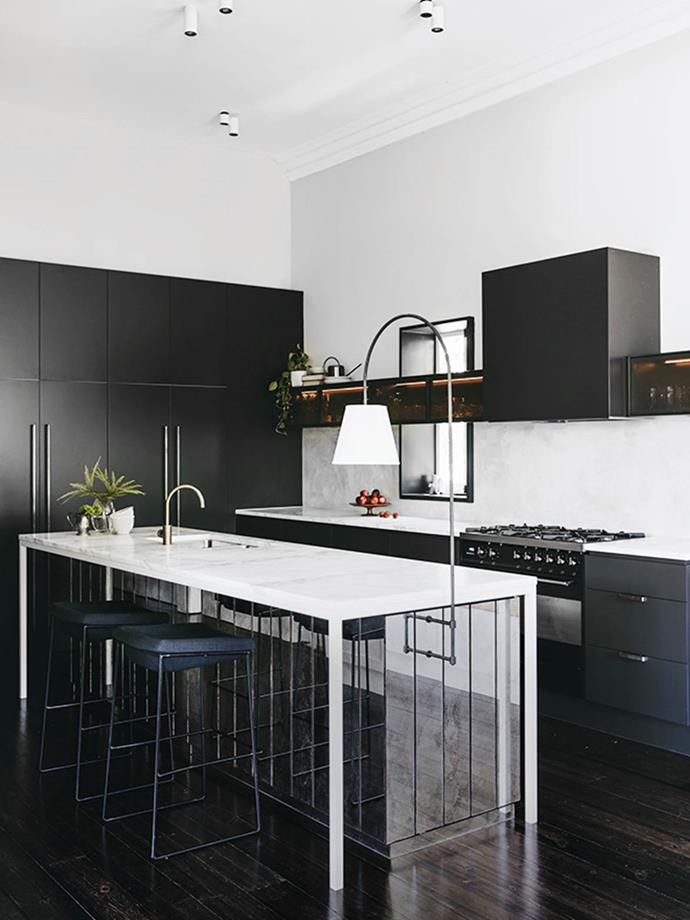 "Designer Sophia Leopardi says ""With little room to move in terms of footprint, contrast and layering were used in both detailing and materiality to transform a French provincial kitchen into a clean and classic design that sits harmoniously in this heritage home."""