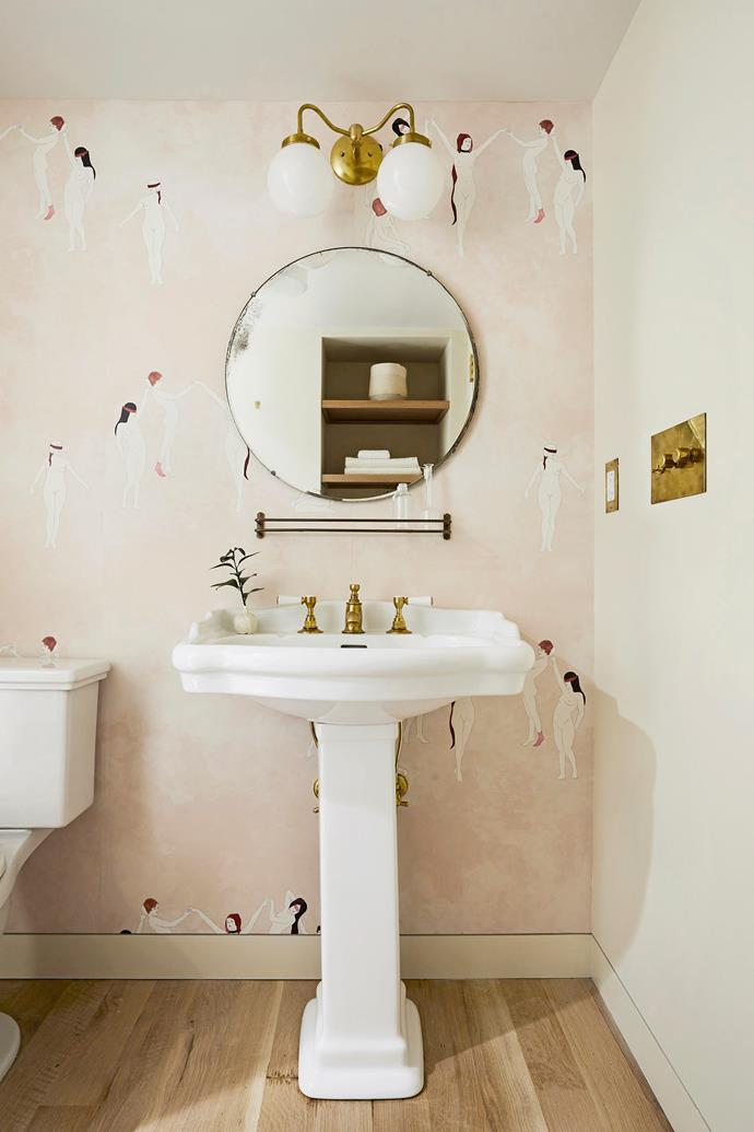 Pair blush hues and romantic motifs with metallic fixtures and traditional tapware for a bathroom that evokes understated luxury.