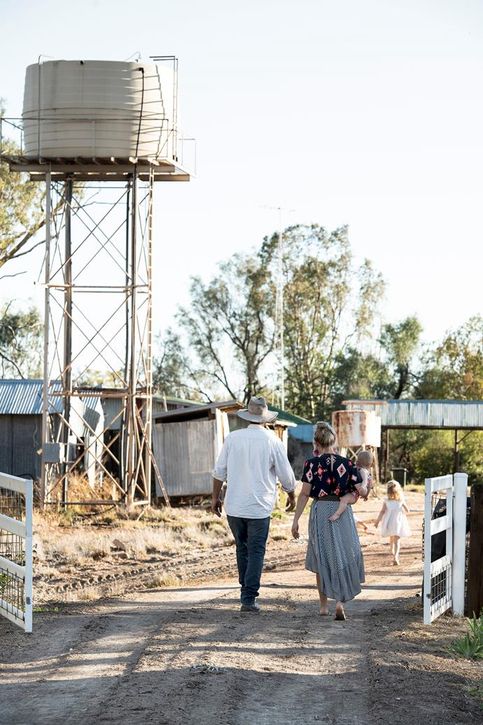 The family strolling out the farm gates to head down to the Barwon River, which now runs dry.