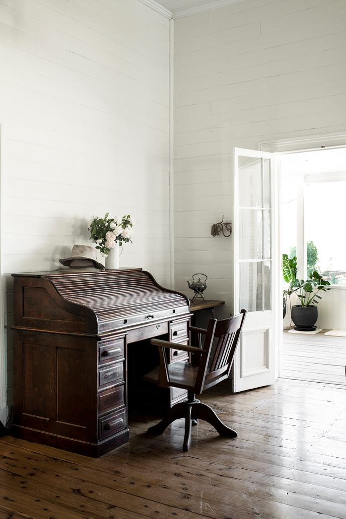 The beautiful roll-top desk was purchased by Jay's parents at an antiques sale, while Katie bought the chair. They occupy a corner of the open-plan family room, which opens onto the verandah.