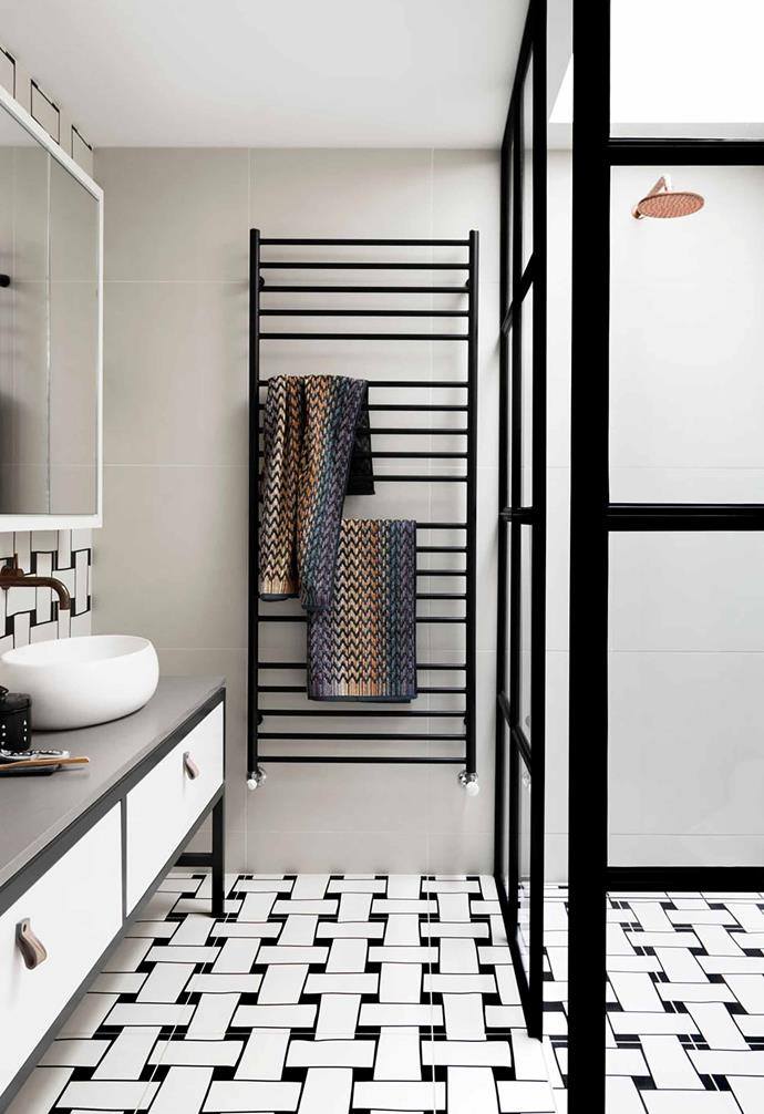 "This [sophisticated home in Toorak](https://www.homestolove.com.au/monochromatic-home-melbourne-toorak-6270|target=""_blank"") was designed to blend modern design with its heritage past and the end result is stunning. In the bathroom, statement basketweave tiles in black and white instantly draw the eye."