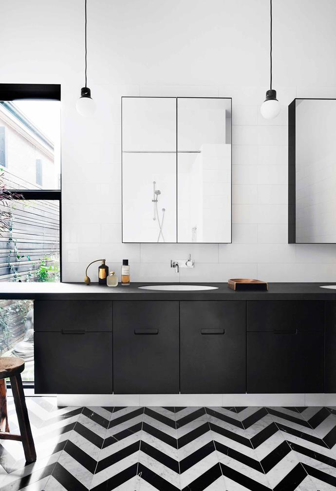 "Black and white tiles laid in a chevron pattern add a dynamic touch to the black and white bathroom in this [Victorian home](https://www.homestolove.com.au/victorian-home-changes-its-outlook-5262|target=""_blank"")."