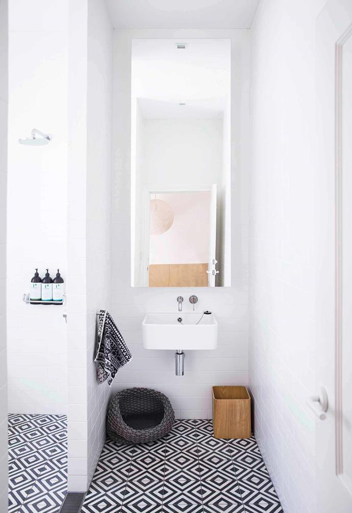 "All-white subway tiled walls in the bathroom of this [relaxed terrace in Paddington](https://www.homestolove.com.au/relaxed-terrace-paddington-18366|target=""_blank"") are contrasted with patterned black and white floor tiles."