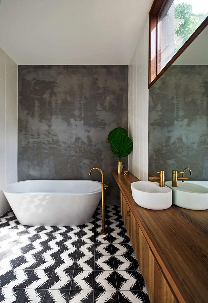 "Touches of brass, timber and concrete give this [luxe bathroom](http://www.homestolove.com.au/bathroom-profile-brassed-beauty-2130|target=""_blank"") an industrial edge."