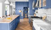 A blue country-style kitchen that embraces natural, durable materials