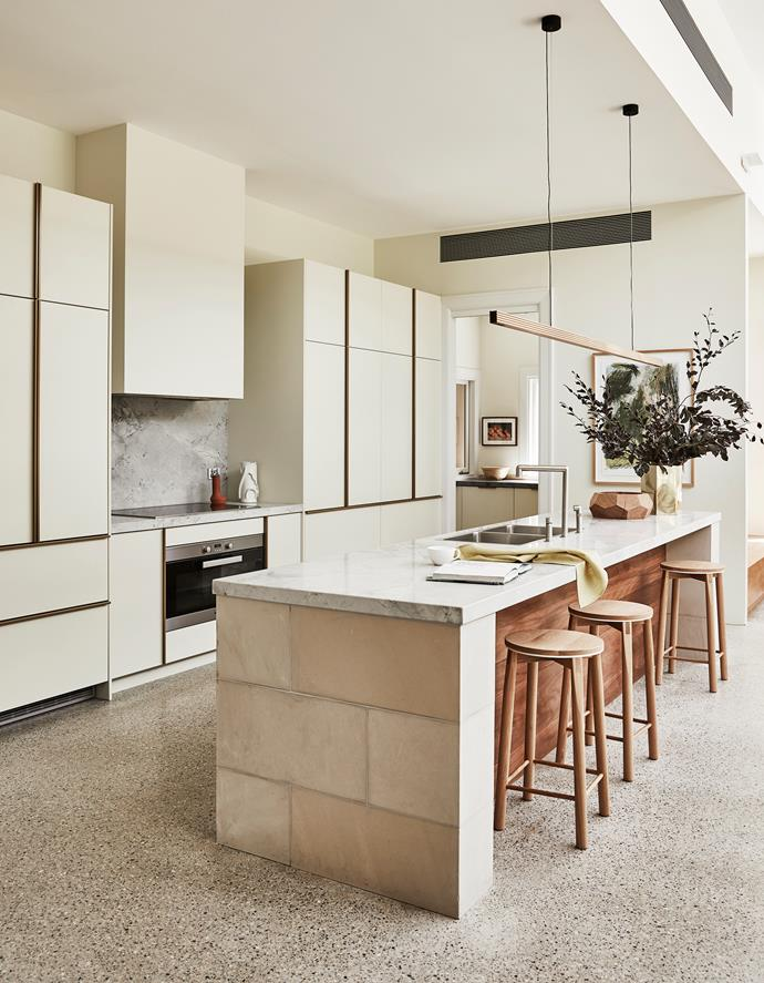 Brett chose two-pack joinery in Dulux Apple Cucumber Half for this space in a nod to the citrus tones in the home's stained-glass windows. The generous island is topped with Super White Quartzite from Granite & Marble Works and edged with sandstone blocks.