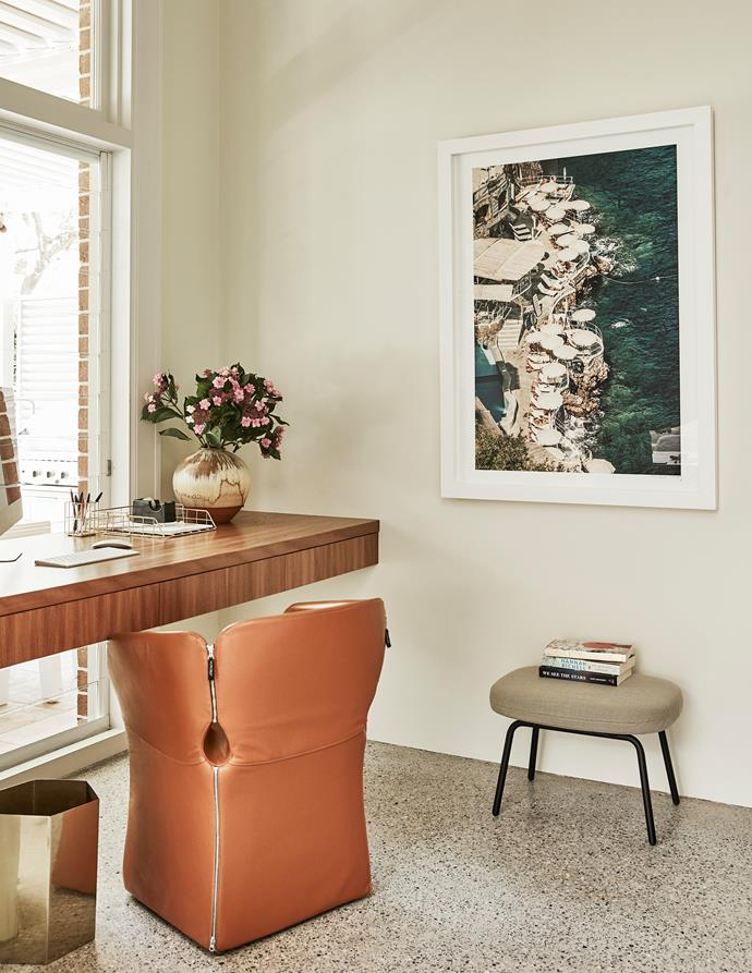 A tan leather Moroso 'Bloomy' chair from Hub Furniture sits at the built-in desk. Hotel Santa Caterina Amalfi framed photograph by Stuart Cantor, MCM House.