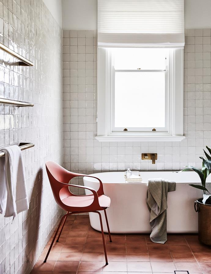 """This room has a quiet kind of glamour,"" says Brett of the bathroom, which features a showstopping Posh Solus freestanding tub from Reece. Handmade ceramic wall tiles, The Art of Tiles. Popham Design floor tiles, Onsite Supply & Design. Elephant chair, Fanuli."