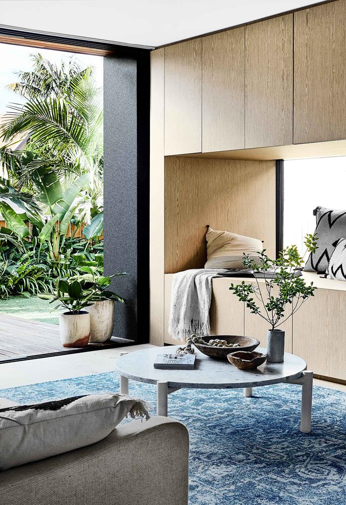 """A striking blue rug helps to ground the open-plan living area in this [Scandi-noir home](https://www.homestolove.com.au/scandi-noir-house-20344