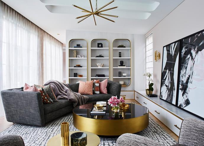 AFC print collection artworks from Arthouse Co. Minotti 'Seymour' sofa from De De Ce. 'Meurice' five-arm wall sconce from Jonathan Adler. Brass and timber joinery by Ciolino Constructions to Greg Natale's design. Walls painted in Dulux 'Portrait Pink'.