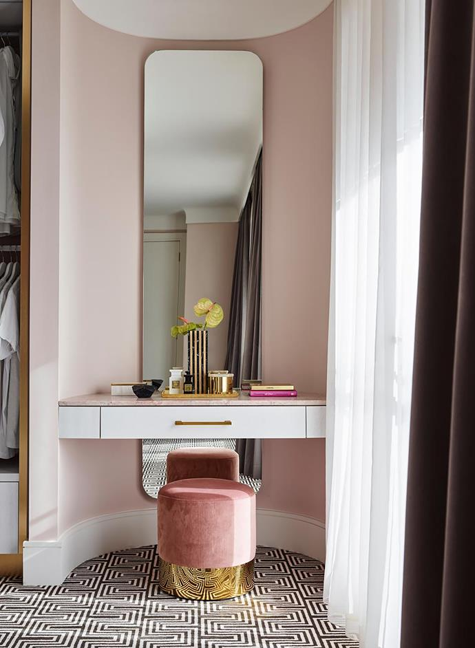 In the walk-in robe, Greg Natale 'Yves' carpet from Designer Rugs. 'Odette' footstool from Brosa. Dressing table and mirror designed by Greg Natale.