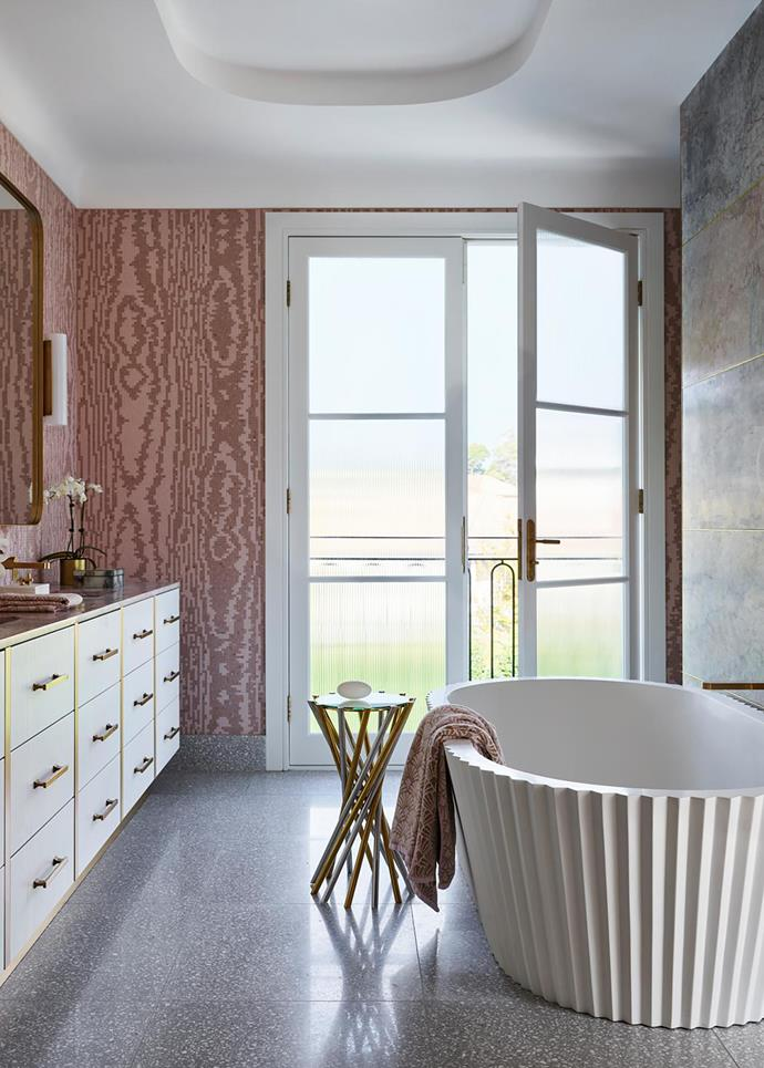 Sophistication rules in the striking ensuite. Walls in Greg Natale 'Moire' mosaic tiles from Bisazza. Kelly Hoppen 'Origami' bath from Apaiser. Electrum accent table from Jonathan Adler. Wall in Purple Oniciata marble tiles from Nefiko Marble. Flooring from Terrazzo Australian Marble.