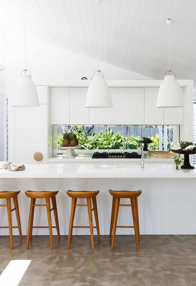 "With a flexible single-storey floor plan, this [light and luxurious home](https://www.homestolove.com.au/fibro-cottage-avalon-20548|target=""_blank"") on Sydney's northern beaches suits the needs of everyone in the family. The owners opted for a predominantly white palette evident in the bright kitchen which features a Corian benchtop and integrated sink in Glacier White and cabinetry, walls and ceilings painted in Dulux Vivid White."