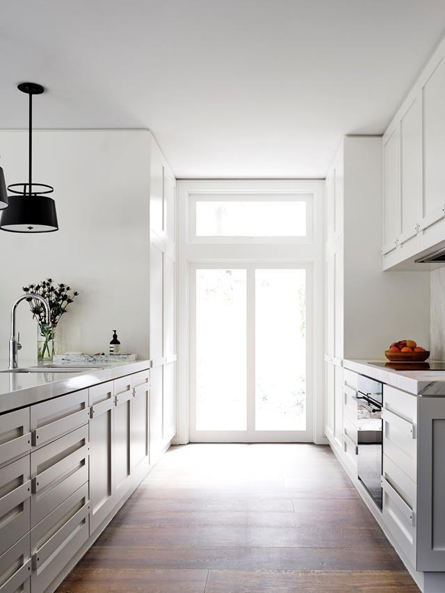 """This was conceived from a desire to extend and open up a dark section of a California-style bungalow on Sydney's leafy north shore,"" says designer Alexandra Donohoe Church and Lisa Medicke of this [understated yet luxurious kitchen](https://www.homestolove.com.au/9-luxury-dream-kitchens-4282